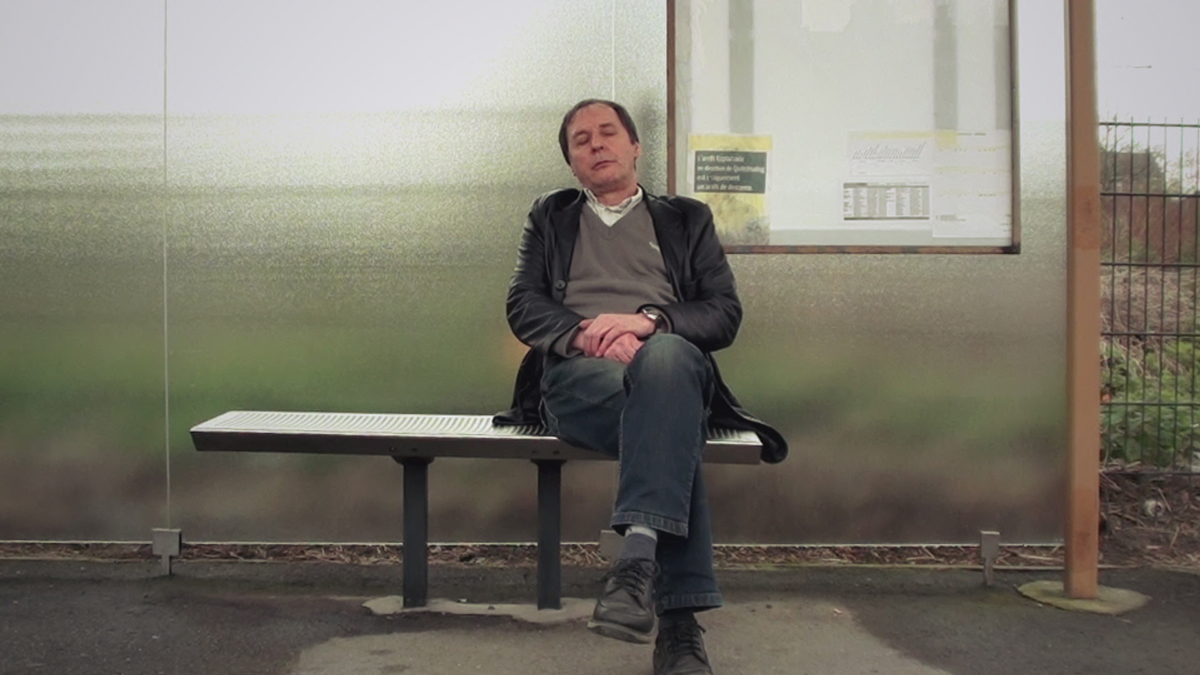 The man sleeps in a bus station