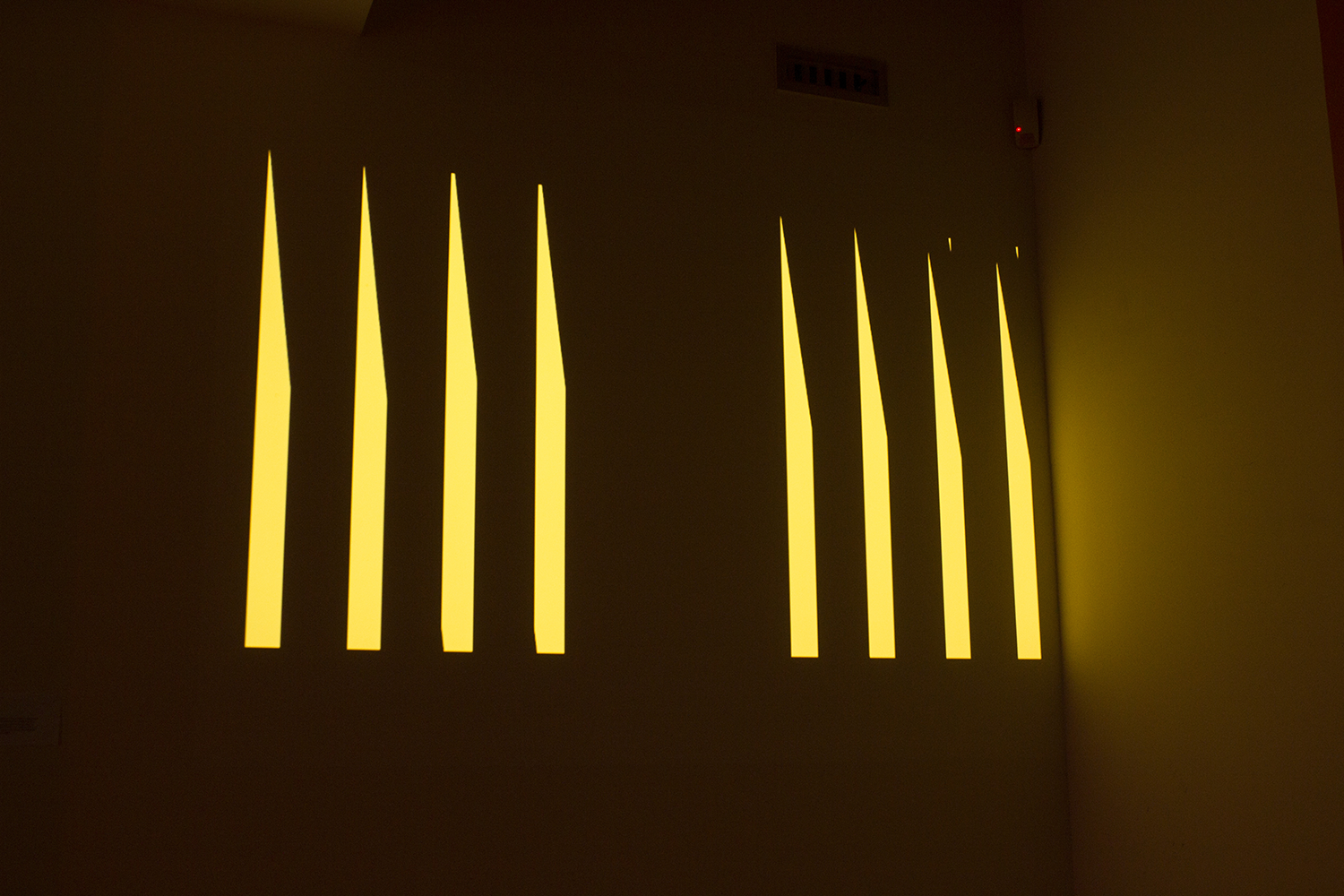 Projection of yellow geometric forms